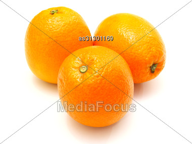 Three Ripe Oranges Lie Nearby Stock Photo