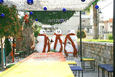 Three Snowmen And Little Gnome Waits The Christmas Stock Photo