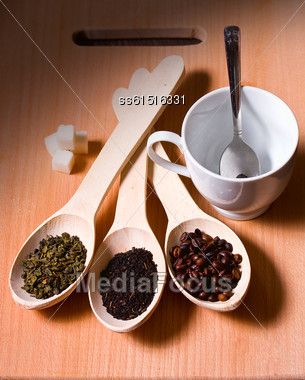 Three Spoons With Green And Black Tea And Spoon Cup Of Coffee Stock Photo