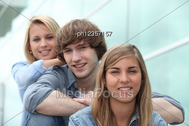 Three Students Sitting On Stairs Stock Photo