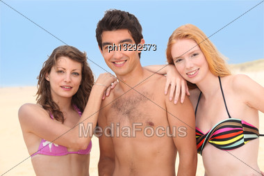 Three Teenagers At The Beach Stock Photo