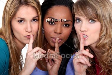Three Women Shushing Stock Photo