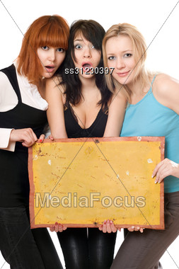 Three Young Surprised Women Taking Vintage Yellow Board Stock Photo