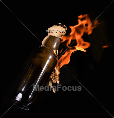 Thrown Bottle With Molotov Cocktail And Burning On Black Background Stock Photo
