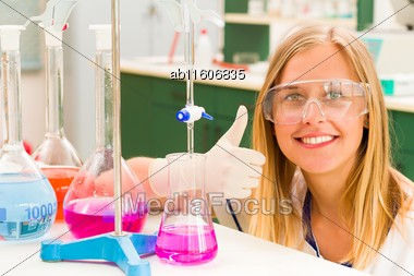 Thumbs Up From Blond Student After Successful Titration Stock Photo