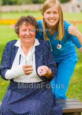 Thumbs Up From Doctor For D Vitamin And Alternative Medicine Effective For Injured Elderly Woman Stock Photo