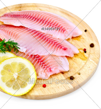 Tilapia Fillets With Dill, Lemon Slices, Peppercorns On A Wooden Board Isolated On White Background Stock Photo