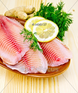 Tilapia Fillets With Lemon And Dill In Pottery, Ginger Root On The Background Of Wooden Boards Stock Photo
