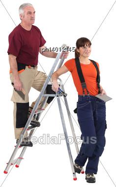 Tiler And Female Helper Stock Photo