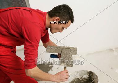 Tiler At Work Stock Photo