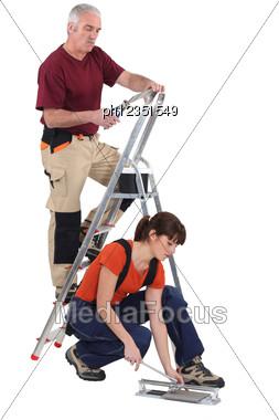 Tilers Working Stock Photo