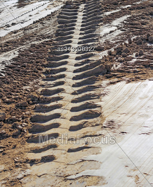 Tire Tracks Perspective Prints In Clay Stock Photo