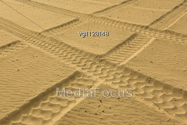 Tire Tracks Perspective Prints In Sand On A Beach Stock Photo