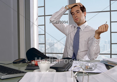 Tired Man At The Office Stock Photo