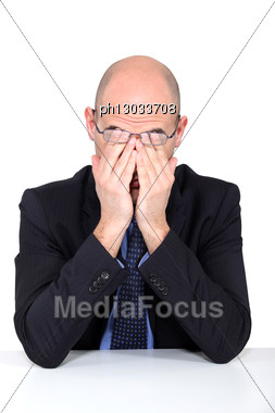 Tired Man Rubbing His Eyes Stock Photo