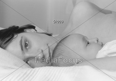 Tired Mother and Baby Stock Photo