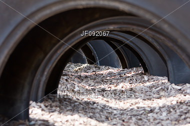 Tires And Mulch As Part Of A Childs Playground Stock Photo