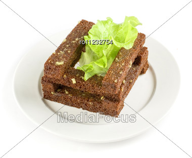 Toasted Bread Closeup With Garlic At Lettuce Leaf On White Stock Photo
