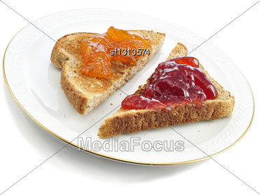Toasts With Jam On A Plate Stock Photo