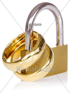 Together Forever. Golden Wedding Ring Locked For Forever Love Stock Photo