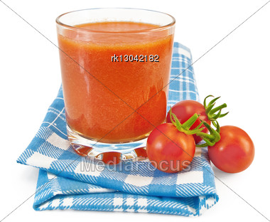 Tomato Juice In A Glass, Three Small Tomatoes On A Blue Checkered Napkin Stock Photo