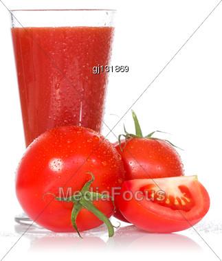 Tomato Juice And Ripe Tomatoes On White Background Stock Photo
