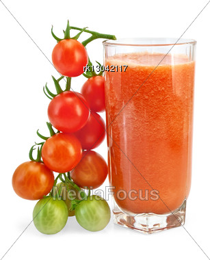 Tomato Juice In A Tall Glass With A Bunch Of Small Tomatoes Stock Photo