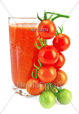 Tomato Juice In A Tall Glass With A Sprig Of Small Tomatoes Stock Photo
