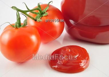 Tomato Ketchup And Fresh Tomatoes , Close Up Stock Photo