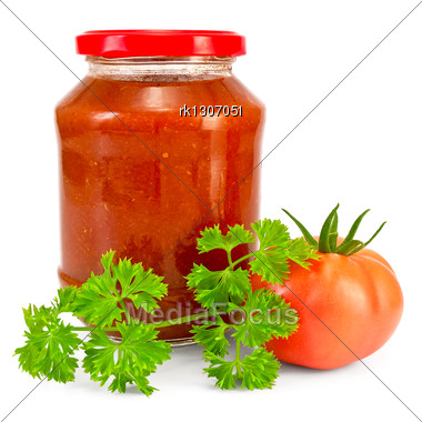 Tomato Ketchup In A Glass Jar, One Tomato, A Sprig Of Parsley Stock Photo