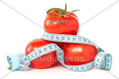 Tomatoes Wrapped With Measuring Tape To Signify Weight Loss Stock Photo