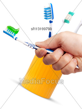 Toothbrush And Toothpaste In A Hand Isolated On White Background Stock Photo