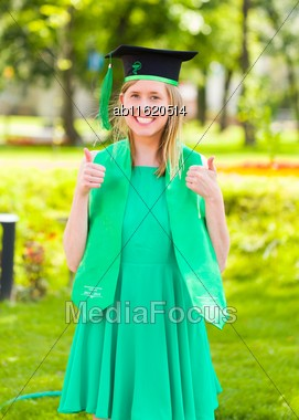 Toothy Smile Fom Positive Pharmacist Graduate With Cup And Snake Symbol On Her Hat Stock Photo