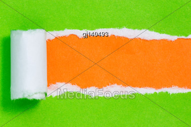 Torn Green Paper On Orange Color Background With Space For Text Stock Photo