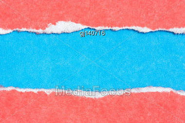 Torn Paper Red And Blue Colors For The Background Stock Photo