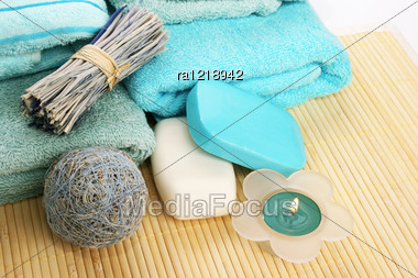 Towels And Decoration On Bamboo Mat. Stock Photo