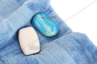 Towels And Soaps On White Background. Stock Photo