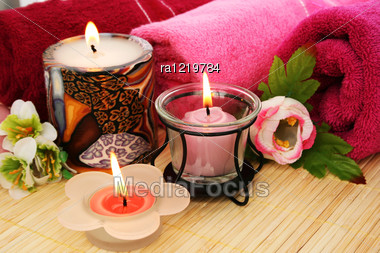 Towels, Candles And Flowers On Mat Background. Stock Photo