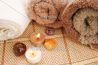 Towels, Candles And Stones On Mat Background. Stock Photo