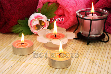 Towels, Soap, Candles And Flower On Mat Background. Stock Photo