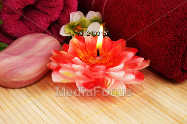Towels, Soap, Flower And Candle On Mat Background. Stock Photo