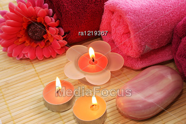 Towels, Soap, Flower And Candles On Mat Background. Stock Photo