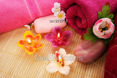 Towels, Soaps, Flowers And Candles On Mat Background. Stock Photo