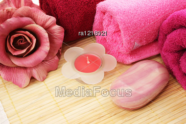 Towels, Soaps And Flowers On Mat Background. Stock Photo