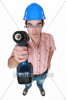 Tradesman Holding A Power Tool Stock Photo