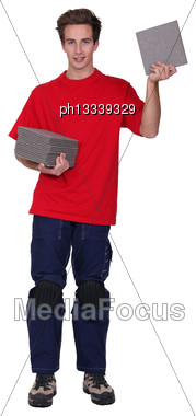 Tradesman Holding A Stack Of Tiles Stock Photo
