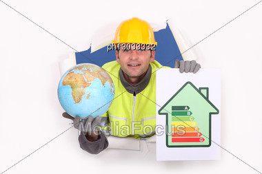 Tradesman Holding A Globe And An Energy Efficiency Rating Chart Stock Photo
