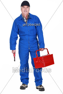 Tradesman Holding A Tool And His Toolbox Stock Photo