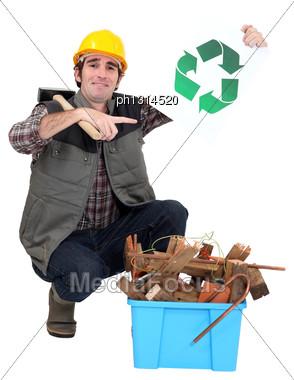 Tradesman Kneeling Next To A Bin Stock Photo