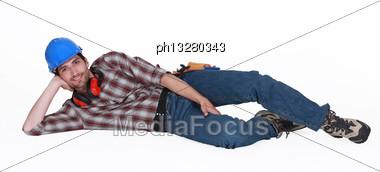 Tradesman On The Ground Stock Photo